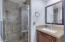 Remodeled Downstairs Bathroom w/custom cabinets/granite countertops and Glass shower enclosure.