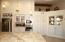 Kitchen features pull outs in cabinets and built in appliances.