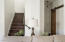 Stairwell to secondary bedrooms & laundry room with barn door