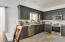 Granite counters, tile backsplash and stainless steel appliances