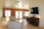 Main entrance leads to the large family room with the formal dining tucked away into the back right of this open floor plan. Kitchen to the immediate right.