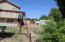 View from the back block wall towards the house and RV gate on the right side in this picture.