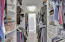 Walk in Closet with Custom Cabinets