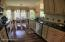 Galley kitchen with custom cabinets and granite counters