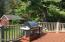 Large Deck overlooks fenced yard and guest house