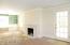 Livingroom, marble mantle, door to screened porch