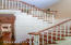 Graceful staircase leads to 3-4 bedrooms