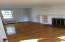 Huge living room with fireplace, oak floors