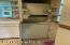 compact washer/dryer in kitchen. (owner never used & put full size in basement)