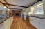Open concept kitchen, dining, living room. Wood beamed ceiling.