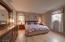 Oak wood floors. Primary Bedroom measures 13.6x14.10.