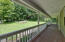 Expansive front porch with Mahogany flooring