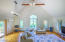 The bright living room has a cathedral ceiling.