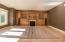 Gas fireplace with wall-to-wall built-in entertainment center. Alder cabinetry.