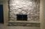 Beautiful stone fireplace - see thru to office