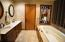with deep tub, double vanities, and stand alone shower