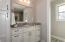 Cabinet linen closet in master bathroom