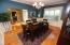 Gorgeous hard wood floors through out the home. Wainscoting adds a touch of elegance.