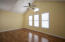 located on main level, vaulted ceiling, triple windows
