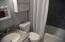 Remodeled in 2013 - tile, flooring, vanity, tile border around shower, lighting, toilet and paint.