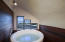 The new Japanese soaking tub with surrounding Ipe paneling was the idea of Chris Brace of Brace Builders, the renovation contractor. He created a spa feel for this special location in the house.