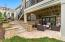 Lower level walk-out lounge/entertaining steps up to additional outdoor spaces