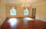 Large Dining Room with beautiful crown molding and wainscoting.
