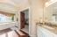 Boasting dual vanities and a soaking tub