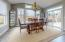 • New laminate flooring ~2017 • Mindful grey painted walls • Tray ceiling • Hanging chandelier • Double sliding doors to Aggregate patio • Shades remain
