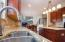 Granite counters and touch-on faucet.