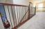 Open hallway on 2nd story with iron balusters.