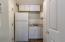 Dedicated Mudroom with Additional Refrigerator, Sink, and Storage right off the Garage
