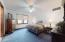 """• Blue carpet • Ivory painted walls • Lighted ceiling fan • 2"""" blinds"""