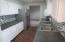 Kitchen with white cabinets and lamiate flooring