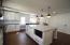Additional storage under the island for seasonal kitchen use. Plentiful pantry storage surrounds the refrigerator.