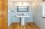 Half Bath with hardwood flooring and pedestal sink