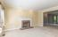 Living Room (12'3 x 14'6) features woodburning fireplace with brick surround, and crown molding