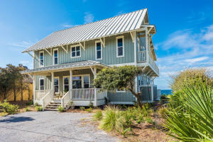 ClassIC Beach House design features board and batten wood siding, seamless metal roof