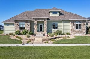 Gorgeous exterior with stone entry and tasteful landscaping