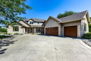 Angled Driveway & Front Porch Nestled in Mature Trees & Landscaping