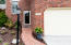 Brick Walkway with Professional Landscaping and Hardscaping