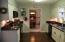 Recently updated kitchen with newer cabinets, granite tops, & SS under mount sink.