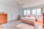 Expansive sunlit bedroom has double closets, ceiling fan and private bathroom- perfect for family or guests