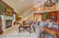 Great room/ Family room with rear stairway from upstairs