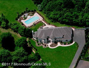 European estate home on very private 3.11 acres.