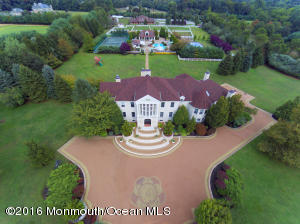 GORGEOUS FRONT AERIAL VIEW OF HOME SHOWS THE LAYOUT OF THE 10 ACRE PARCEL