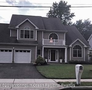 Custom Center Hall Colonial with beige vinyl siding. Two car garage. Two story foyer & Great Room, custom windows & décor.