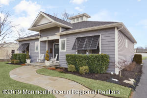 Welcome Home! Bluestone pathway leads to a delightful seashore inspired home, complete with custom plantation shutters.