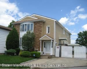 Welcome to 25 Mott Street! Very large 6 over 6 legal two family with finished basement!