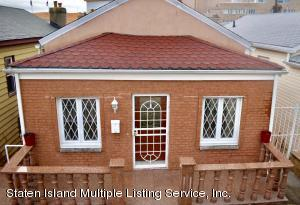 Gorgeous brick and stucco front view with granite railings and floors on porch